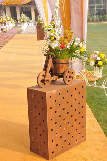 Photo of wooden cycle and box entrance decor