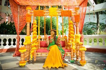 genda flower mehendi swing decor