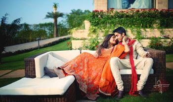 romantic couple pre-wedding shot with bride wearing coral color anarkali