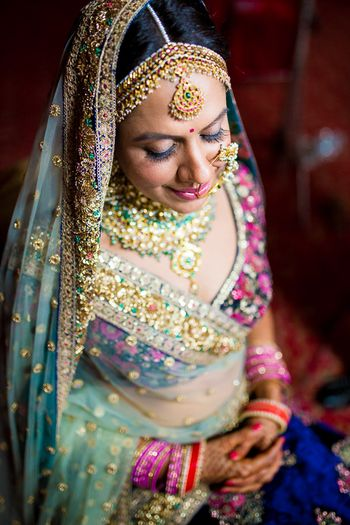 Bride in blue sabya lehenga