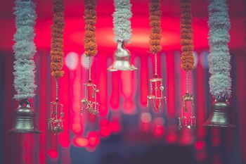 Hanging floral strings with temple bells and kaleere