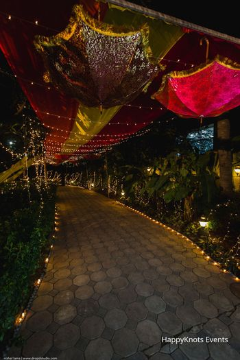 suspended umbrellas mehendi entrance decor