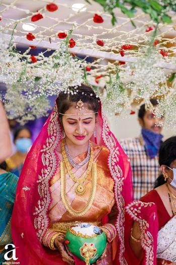 Bride entering under baby's breath phoolon ki chaadar