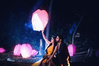 Couple releasing lantern pre wedding shoot prop