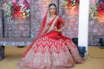 Red bridal lehenga with silver motif work