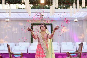 Cute bridal photo idea with bride throwing rose petals