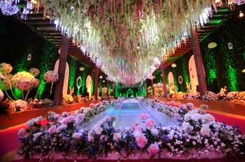Floral aisle with hanging floral ceiling