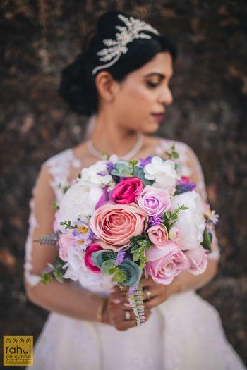 Bride holding a floral bouquet.