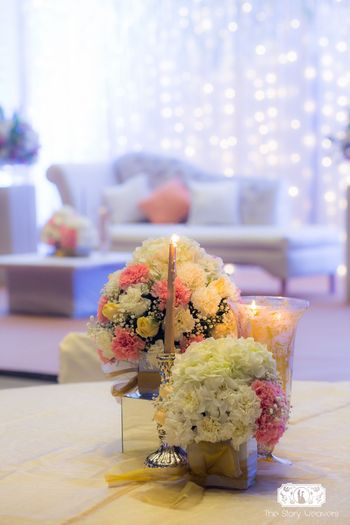Floral centerpiece with flowers and candles