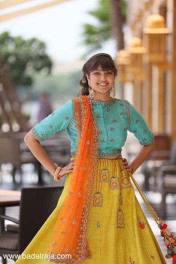 Photo of Yellow lehenga with birdcage embroidery and aqua blouse