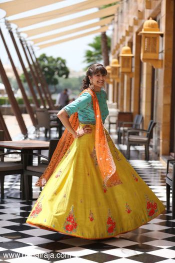 Turquoise and yellow lehenga for mehendi with high neck blouse
