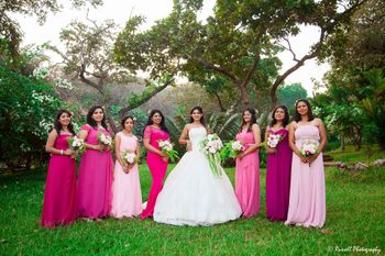 Bride in white gown with matching bridesmaids in pink