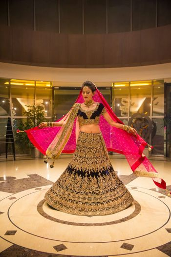 Blue velvet bridal lehenga with gold work and pink dupatta
