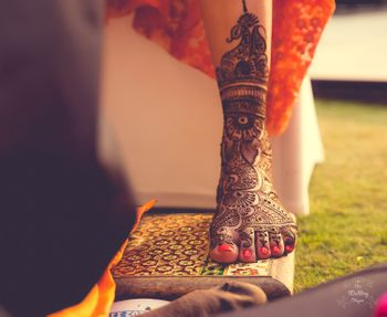 Photo of bridal feet mehendi design