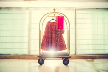 Photo of Lehenga on hanger at hotel trolley