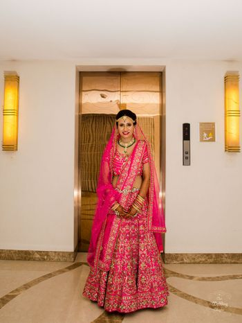Photo of Bright pink bridal lehenga with floral embroidery
