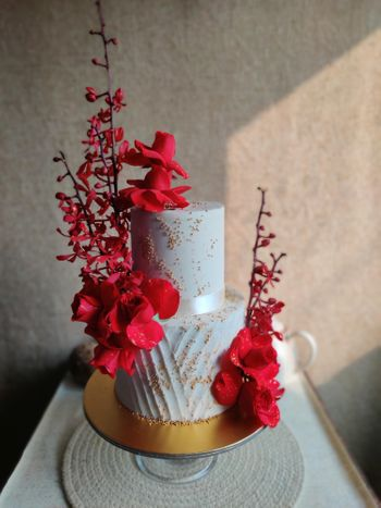 Two-tier white wedding cake with flowers.