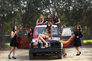 Bride with bridesmaids on jeep for bachelorette shoot