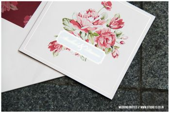 white and floral wedding card