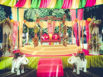 colorful mehendi stage decor