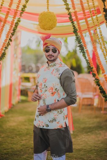 Mehendi groomwear with white and peach floral print nehru jacket