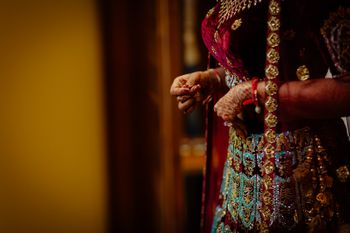 Photo of Maroon velvet lehenga with turquoise detailing work