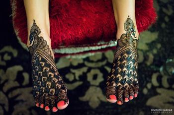 Unique peacock theme bridal mehendi design on feet