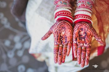 Traditional design mehendi with bride and groom portraits