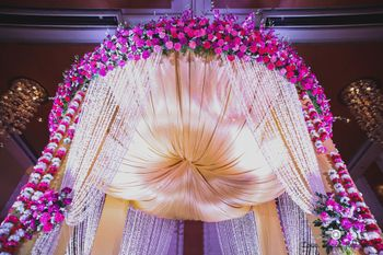 Photo of Gold and pink floral decor mandap