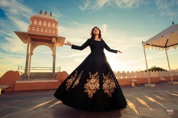Elegant black and gold gown for pre wedding shoot