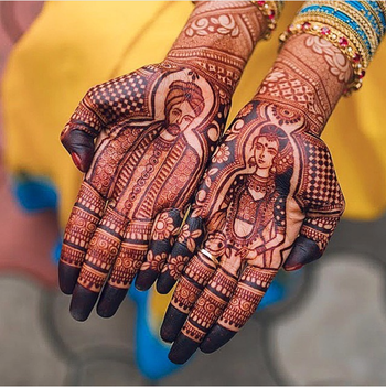 Intricate hand mehndi design with bride and groom portrait