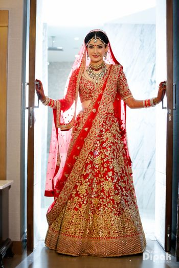 Photo of Red and gold bridal lehenga with sequin work all over