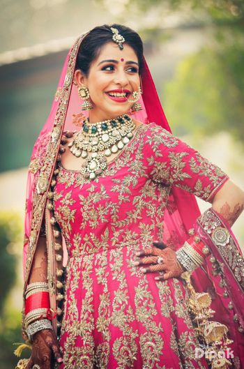 Photo of Contrasting bridal jewellery with pink anarkali on sikh bride