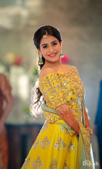 Photo of Yellow gota patti off shoulder lehenga