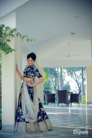 Navy blue lehenga with floral motifs for sangeet