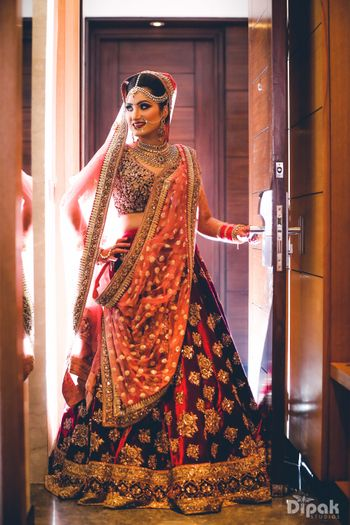 Photo of Marsala and gold bridal lehenga