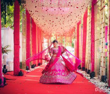 Twirling bride in hot pink bridal lehenga