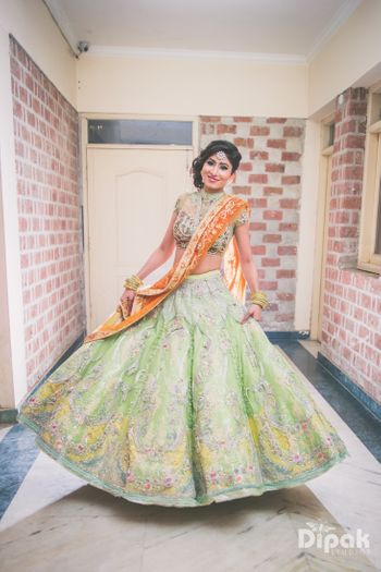 Colourful lehenga for sangeet or reception with light green and yellow