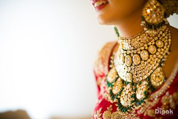 Elaborate bridal necklace with green beads