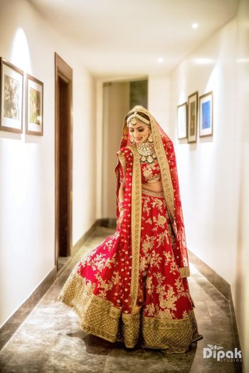 Red and gold floral embroidery lehenga for bride
