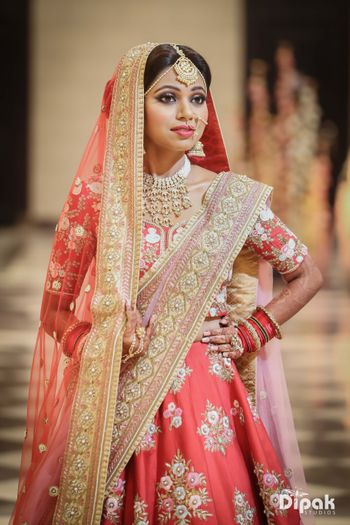 Embellished floral bridal lehenga in coral and lilac combination