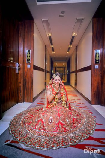 Red bridal lehenga with scalloped edge