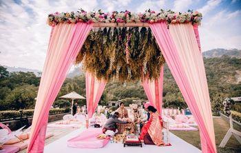 simple mandap decor with drapes and botanicals