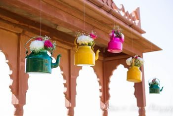 Photo of hanging floral kettles