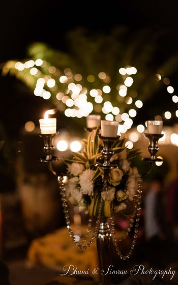 Photo of Candle stand corner wedding decor
