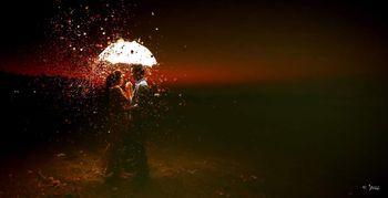 romantic couple shot with rose petals shower
