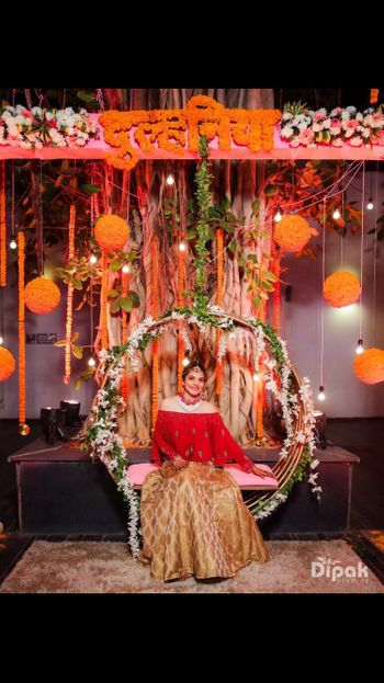 Mehendi decor ideas with bride on bridal jhoola