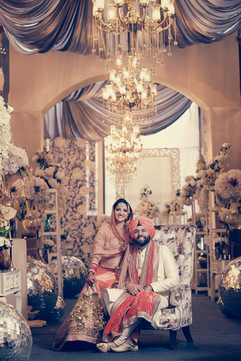 chandeliers and floral sikh wedding decor