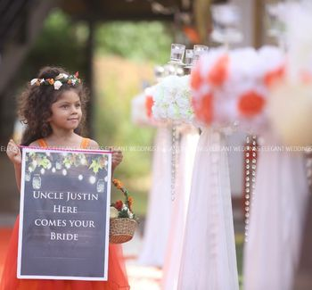 Photo of kid holding placard at wedding