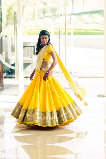 twirling bride in yellow lehenga